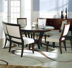 gorgeous wood and metal dining table with metal chairs and bench