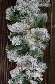 Christmas Tree Flocking Spray Uk by Premier 2 7m Snow Flocked Pine Christmas Garland With Glitter