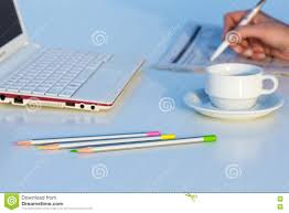 Download Angle View Of Work Place With Laptop Color Pencils And Business Newspaper Stock Image