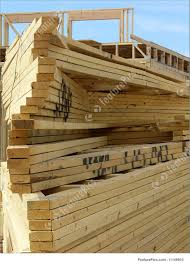 100 House Trusses Building Construction Stack Of Prefabricated Root Trusses In Front Of House Under Construction