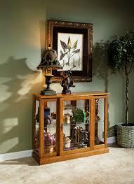 console curio cabinet in golden oak iii by pulaski home gallery
