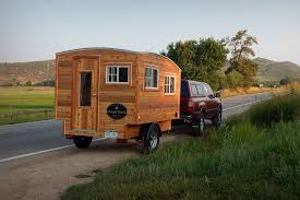 A Terapin Camper Trailer Hitched To Truck