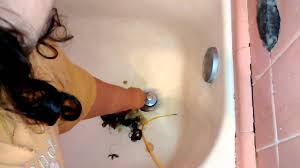 Unclogging Bathtub With Snake by Unclog Bathtub Drain With Wire Hanger In 3 Minutes Youtube