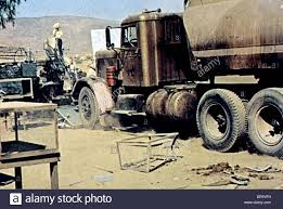 TRUCK DUEL (1971 Stock Photo, Royalty Free Image: 30930021 - Alamy Scvhistorycom Obituaries Dennis Weaver Western Actor Cinemaspection Movie Injokes Torque Duel Steven Spielberg 1971 Road Reviews Top 5 Cars And Trucks From Hror Movies Youtube Stars Aligned Five Onic Trucks Together For The First Time Analyse An American Classic A Tribute To Pilot And Humitarian Stock Photos Images Alamy Vudu Jacqueline Scott Ancker Truck