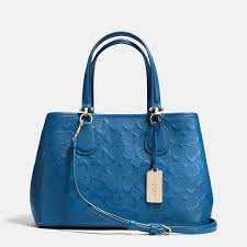 small kitt carryall in logo embossed leather got to have coach