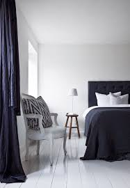 Bright And Elegant Bedroom Featuring A Kingsize Bed With Black Headboard We Love The