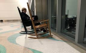 Fort Lauderdale Airport Has Rocking Chairs To Sit And Watch The ... Rocking Chair On The Wooden Floor 3d Rendering Thonet Chair At Puckhaber Decorative Antiques Man Sitting Rocking In His Living Room Looking Through Costway Classic White Wooden Children Kids Slat Back Fniture Oak Creating A Childrens From An Old Highchair 6 Steps Asta Recline Comfy Recliner Mocka Au Happy Pregnancy Sitting On Stock Image Of Jackson Rocker Click Black New Price Vintage Hitchcock