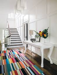 airy classic staircase patterned colorful carpet on wooden floor