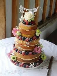 Naked Wedding Cake Uniced With Fresh Fruits And Flowers Vintage Bunting Topper