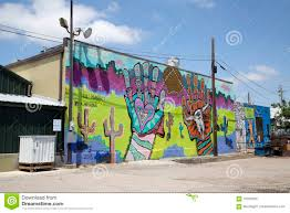 group colorful graffiti on the wall of building editorial photo