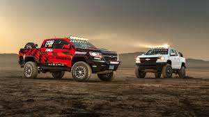 These Chevy Colorado ZR2 Concepts Turn Trucking Up To 11 - The Drive American Offroad Vehicle Pickup Truck Dodge Ram 1500 57 L Ricky Carmichael Chevy Performance Sema Concept Motocross Sun City Diesel Automotive Parts Alligator Falcon Shocks Introduces New Systems Work Palmyra Me Defiance Off Road Automobile Accsories Boerne Tx San Antonio And Repair 6 Mods For Style Miami Lakes Blog Era Ford F150 Ford Is It Better To Buy A Or Used In Clinton