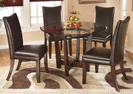 Charell Round Dining Table W 4 Brown Side ChairsSignature Design By Ashley