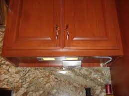 cabinet lighting with outlets stagger kitchen cupboard