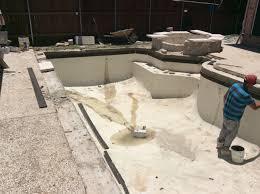 swimming pool renovation during replacing plaster tile coping