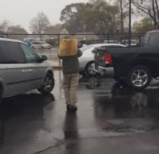 This Guy Using His Truck Floor Mat For An Umbrella. : Peopleofwalmart
