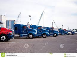 100 Huge Trucks Big Rigs Semi Standing In Row On Parking Lot At