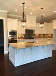 White Cabinets Dark Gray Countertops by Sherwin Williams Pure White Cabinets Worldly Gray Walls White