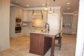 classic kitchen area with glass shades pottery barn pendant lights