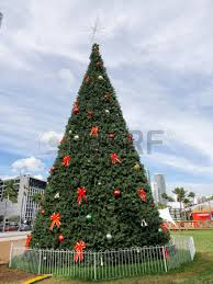 Christmas Tree In Miami USA On Cloudy Sky Background Holiday Decorations With Balls And