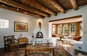Rustic Spanish Style Living Room With Cement Fireplace And Large Round Wood Beams