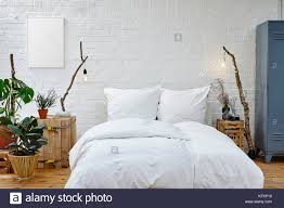 100 Urban Loft Interior Design Creative Interior Design Urban Loft White Bed And Vivid Plants Stock