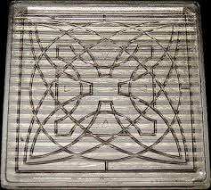 luxfer glass prism tile with flower design by frank lloyd wright