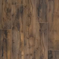 Trafficmaster Glueless Laminate Flooring Lakeshore Pecan by Pergo Outlast Vintage Tobacco Oak 10 Mm Thick X 7 1 2 In Wide X