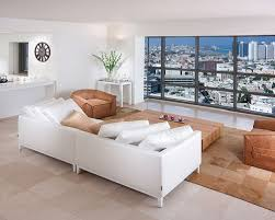 Trendy Open Concept Living Room Photo In Other With White Walls