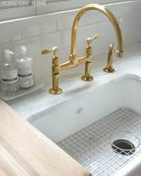 satin wide spread unlacquered brass kitchen faucet single handle