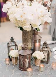 I Like The Tall Vase In Middle And Little Lanterns Tealight Candles Surrounding It However Im So Tired Of People Calling Things Rustic When