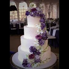Classic Four Tier Wedding Cake With Stunning Purple Fresh Flower Arrangement By Sweet Memories Bakery
