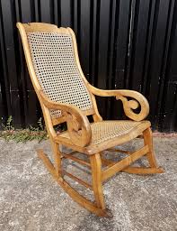 Early 20th Century Birds Eye Maple Rattan Rocking Chair With Some Repairs.