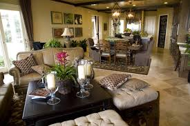 Lush Details Abound In This Open Living Room Shared With Dining And Kitchen Space