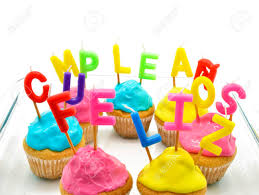 Birthday cupcakes with candles happy birthday in Spanish Stock