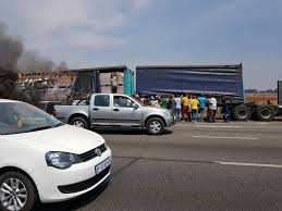 intelligence bureau sa looters descend on burning truck on r21 kempton express