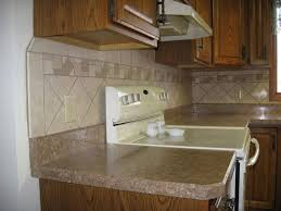 white kitchen cabinets gray granite countertops leather wall tiles