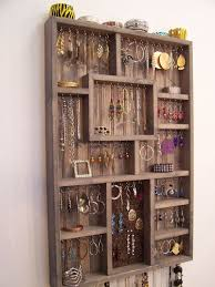 23 DIY Display Cases Ideas Which Makes Your Stuff More Presentable Jewelry HangerJewelry WallJewelry