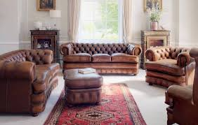 Rustic Living Room With Stone Wall Featuring Leather Sofa And Chairs