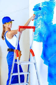 Happy Smiling Woman Painting Walls In New Apartments Painter Overalls Paints The Wall Blue Color Occupation Photo By Prometeus