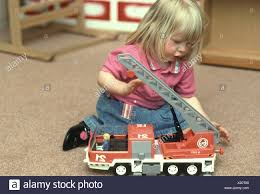 Nursery School Girl Playing With A Toy Fire Truck Stock Photo ... Fireman Wall Decal Firetruck Nursery Wall Art Fire Engine Visits Tynemouth At Billy Mill Beddings Car Crib Bedding Beddingss On Boutique Truck Large Vtg Fisher Price Little People Lot Of 76 Nursery Fire Truck Sisi And Accsories Baby 104367 Fire Truck Toddler Toys Online Shoes Alice Joseph Kids Store Pictures To Print 2251872 Boy Red Navy Blue You Are Vancouver Firefighter Shower The Queen Showers