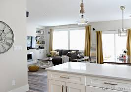 Benjamin Moore Edgecomb Gray With Bianco Drift Quartz And Yellow Gold Accents In Open Layout Living Room Dining Kitchen By Kylie M Interiors Online