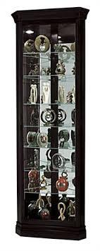 black corner curio cabinet top lighting glass shelves mirror back