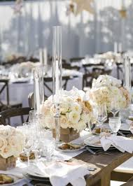 Wooden Tables Topped With Short Floral Arrangements Rustic Elegance