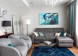 türkis grau wohnzimmer dunkelblauer teppich holzboden