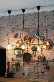 industrial kitchen ideas brick wall light bulbs wood counterop