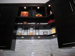 inspired led puck lights in kitchen modern with next to