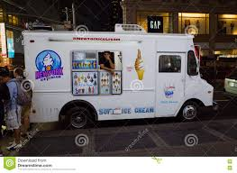 White Ice Cream Truck On A Crowded Street At Night In New York C ...