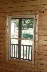 A Beautiful Log Cabin Railing Window Trim Door