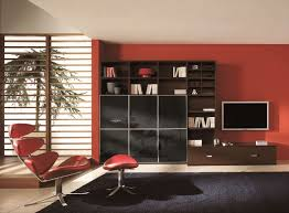 Black And Red Living Room Decorating Ideas by Inspiring Red Living Room Design With Bookcase And Black Rug Red