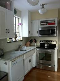 White Small Kitchen Cabinet With Countertop Marble And Stainlees Steel Microwave